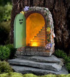 Miniature fairy garden solar stone door miniature fairy gardens 35 easy and beautiful diy fairy garden ideas for inexpensive home decoration Fairy Tree Houses, Fairy Village, Fairy Garden Houses, Solar Fairy House, Fairies Garden, Fairy Garden Doors, Mini Fairy Garden, Fairy Gardening, Indoor Gardening