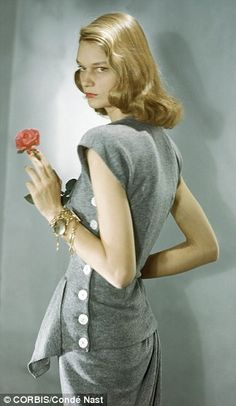Sleeveless, side buttoned, heather grey knitted ensemble, US Vogue, February 1947 by Horst...
