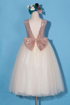 This beautiful rose gold light champagne flower girl dress takes glamour to an extreme as it comes with stylish embellishments. This sleeveless dress has a rose gold sequin embellished bodice, makes your little girl sparkling under both sunshine and party lights. The elegant backless is paired with a beautiful rose gold sequin bow on the waist. The skirt comes with beautiful light champagne ankle length multiple layer tulle and is lined with comfortable high quality same color satin. All the…