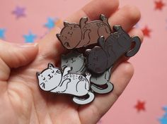 Im so cute! Tickel my tummy! Comes in four diffrent colours - White enamel with black nickel plating Grey enamel with black nickel plating Brown enamel with silver plating Black enamel with silver plating Designed in Devon and made from high quality hard enamel.  Take your cat pals with you everywhere you go! Each pin comes on a backing card and has a rubber butterfly clutch. Pin measures 40mm x 24mm  Order will be posted 2nd class via Royal Mail