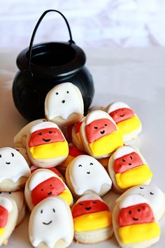 Cheerfully adorable Halloween Ghost and Candy Corn Cookies. #food #Halloween #cookies