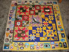 This eagle quilt is amazing = designed and pieced by Connie Doster = machine quilted by Patti Ackerman - Cobalt Quilting = the patches represent ranks and activities thru his Cub Scout and Boy Scout years Eagle Scout Ceremony, Boy Scout Patches, Boy Scout Camping, Boy Quilts, Shirt Quilts, Scout Badges, Brownie Girl Scouts, Patch Quilt, Quilt Blocks