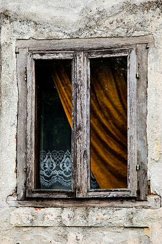 Croatian window, by Vinko Jovanovac……OLD FARMSHOUSE……OLD WINDOW……HOWEVER, BEAUTIFUL LACE CURTAINS….AND HEAVY DRAPES TO HELP SHIELD THE COLD OF WINTER………ccp