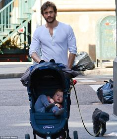 Hugh Dancy. That scruff, those muscles, and a baby. Ovary explosion.