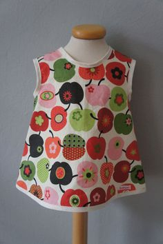 pinafore style dress, red apples