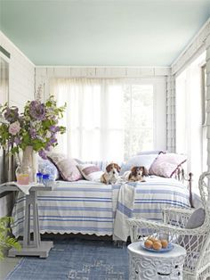 Bright idea: Cover an iron-and-brass daybed with a vintage seersucker coverlet.