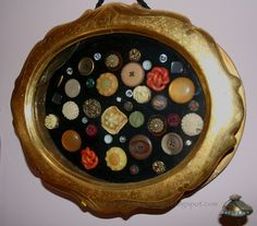 GREAT idea for old buttons--maybe I'll use one of my large oval convex frames and do this for the sewing room.