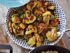 Roasted Cauliflower with Turmeric and Cumin | Fragrant cumin, turmeric, cilantro and mint turn simple roasted cauliflower into a vibrant and delicious dish.