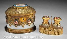 A French Porcelain Gilt Bronze and Opaline Glass Parfumerie 19th c. oval with hinged lid interior with caddy holding two scent bottles decorated with inset porcelain portrait medallions and gilt mounts height 4 1/4 in. width 5 1/2 in. depth 4 1/4 in.