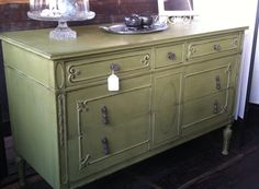 Large solid antique dresser painted in a gorgeous sage.