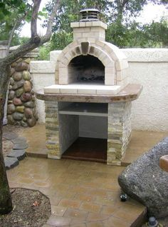 (Brick Wood Ovens) The backyard brick barbeque featured below is not a permanent structure, but a temporary one that also would be relatively easy for a person with limited masonry experience to make in their own back yard. brickbarbe (Dig This Barbeque On Pinterest) Share digg-share facebook-share google-share linked-share my-space-share 2K+ reddit-share stumble-upon-share twitter-share back yard, barbeque, barbequing, birthdays, brick, celebrations, fire pit, gatherings, gradu...