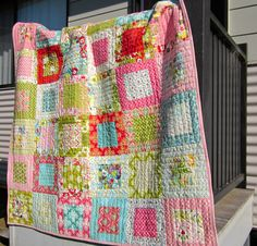 I like the straight line quilting on each block.......Moda pre-cut layer cake quilt