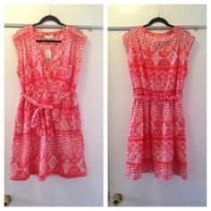 Forever 21 + plus NWT  tribal faux wrap dress 1X Super cute NWT Forever 21+ plus size red and white faux wrap top dress. Super cute 100% cotton tribal print dress. Elasticized waist, belt with loops, side front slant pockets & snap closure on neckline. Brand new with tags! Super cute!! Size 1X Forever 21 Dresses