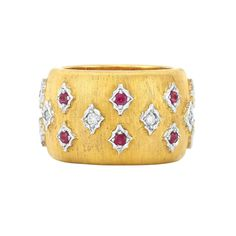 Wide Two-Color Gold, Diamond and Ruby Band Ring, Mario Buccellati   18 kt. yellow & white gold, signed M. Buccellati, Italy, ap. 8.4 dwt.