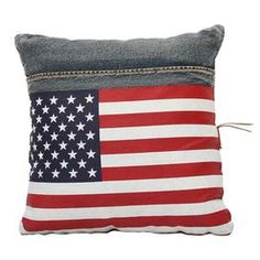 """Recycled denim pillow with an American flag motif.  Product: PillowConstruction Material: Recycled denim and fabricColor: Red, white and blueFeatures: American flag motifInsert includedDimensions: 17.7"""" x 17.7"""""""