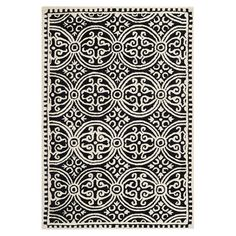Featuring a medallion motif in ivory and silver, this hand-tufted wool rug adds a sophisticated touch to your living room or master suite.  ...