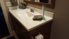 White on Biscuit Vanity top with a Chamfer Edge & Wave Bowl.