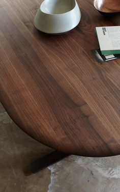 A Close Up Of The Cesar Dining Table By Studio IQ Featuring A Curved Wooden  Edge