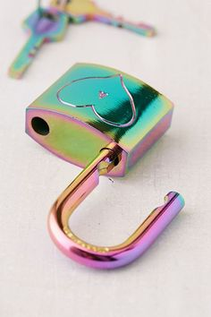 Shop Oil Slick Love Lock at Urban Outfitters today. We carry all the latest styles, colors and brands for you to choose from right here. Unicorn Room Decor, Unicorn Bedroom, Girly Things, Cool Things To Buy, Rainbow Kitchen, Cute Headphones, Zapf Creation, Unicorn Fashion, Cool School Supplies