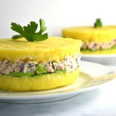 Peruvian causa rellena is the perfect picnic recipe, and such a showstopper. Lemony mashed potatoes are layered with avocado and tuna salad, then unmolded to show off the gorgeous layers. Get the recipe for causa rellena now! Peruvian Dishes, Peruvian Recipes, Cuban Recipes, Avocado Egg Recipes, Potato Recipes, Creamy Mustard Sauce, Custard Desserts, Corn Cakes, Colombian Food