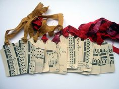 Music Gift Tags- Repurposed Vintage Sheet Music- One Dozen Random Selection- Fabric Strip Strings. $12.00, via Etsy.