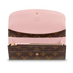 Discover Louis Vuitton Emilie Wallet: Proving that functionality and beautiful design can go together, the Emilie Wallet is elegance itself in supple Monogram canvas with a fresh lining color. Numerous pockets and an attractive shape make it irresistible.