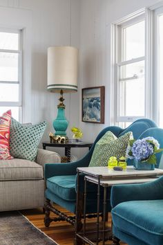 heather vaughan design, beach house, living room, upholstered chair, sofa, bright colors, colors, lamp, woos flooring, area rug, side table