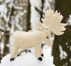 Stitched Moose Felt Ornament, by Cody Foster. Stitched of wool felt. Measures 7.5 inches long. Formerly Backporch Friends American Folk Art, Cody Foster's line of seasonal decor is beautiful and unique, many modeled after vintage/retro designs. $15.99
