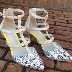 Printed Caged Heels Natural colored caged heels with black and white print in the front. Neon yellow in inside (cannot be seen when wearing). 3.5 inch heel. Very comfortable. Some scuffs on the heels as shown in second picture. Worn once. In great condition. ❌NO TRADES❌ ALDO Shoes Heels