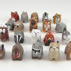 Each totem is sculpted out of polymer clay and measures roughly 1.5 inches. The simple sculptural design makes them sturdier than most decorative figurines, and they fit more comfortably in your jacket pocket. The piece is then cured and meticulously hand painted with as much care and attention to detail as my regular figurines-- right down to their teeny faces-- for maximum character and cuteness. The totem is then coated with several layers of protective varnish, for a smooth matte finish…