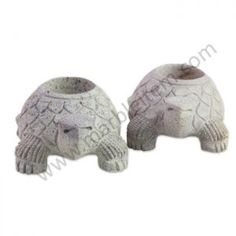 Cheerful terrapins carry tea lights in their shells as they walk steadily toward their goal. Hand-carved of soapstone these turtle twins by Gulam Rasool make delightful candleholders.