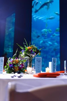 A gorgeous wedding at the NC Aquarium at Fort Fisher courtesy of Fiore Fine Flowers.