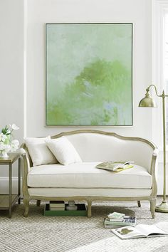A very traditional settee is brought to live with abstract art. The colors are soothing. like nature!