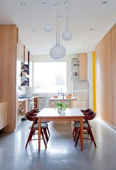 Contemporary Dining Room by Novell Design Build