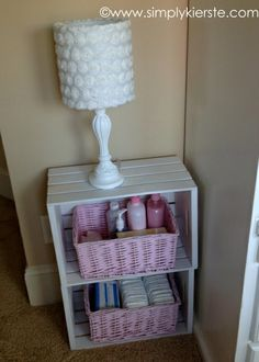 Two Michael's crates painted white and stacked on top of each other to make a nightstand. Cute! {simplykierste.com} And I could do Mint baskets!.