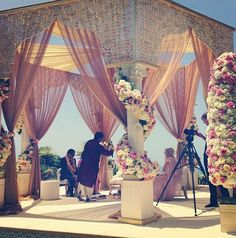 We love the sheer fabric used on this gazebo and flowers around the pillars