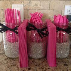 Part of the decorations for my daughter's first birthday party. Mason jars with glass vase filler; raffia bows. Add some utensils and napkins, and there you go!