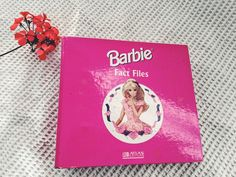 """Look out for this - soon on ebay! Barbie Fact File from 1999. COLLECTABLE and RARE An lever arch folder with 8 sections, each with fold out cards detailing Barbie and various fun things for children.  Barbie™ doll is one of the most iconic toys in history, but there's so much more to her than a pretty face. Her birthday is March 9, 1959. Her full name is Barbara Millicent Roberts. Barbie was """"born"""" in the fictional town of Willows, Wisconsin, in the USA. According to Mattel, the best-selling…"""