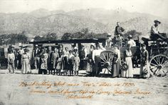 "Farm workers in Chatsworth, 1900. The fruit cutting shed behind the workers is near the ""Tex'a"" place. The second woman on the left is Emma Johnson Graves. San Fernando Valley History Digital Library."