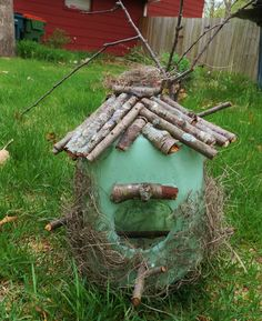 Homemade from a Milk Carton. Green paint, glue, moss, and backyard sticks. No further instructions. Very pretty, and does offer some rain protection for the food inside. Milk Carton Crafts, Milk Cartons, Milk Jugs, Homemade Bird Houses, Diy Bird Feeder, Bird Crafts, Vbs Crafts, Nature Crafts, Flower Bird