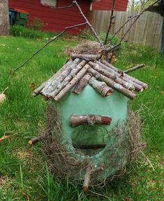 Milk Gallon Jug Bird Feeder. Birdfeeder. Homemade Craft. Milk Carton. Green paint, glue and backyard sticks