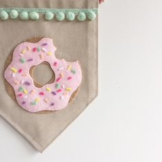 Single sided banner made from quality cotton fabric, machine stitched on all sides. Carefully hand cut and hand stitched felt donut, complete with colourful felt sprinkles and mint pom pom trim.W x L oak rod Felt Crafts Diy, Easy Diy Crafts, Yarn Crafts, Crafts To Sell, Crafts For Kids, Arts And Crafts, Donut Decorations, Sewing Projects, Diy Projects