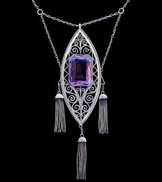 THEODOR FAHRNER   A fine silver pendant set with a large central amethyst.  German c.1900. Obscured mark to clasp and '935' 'depose'.  Size: Height of pendant