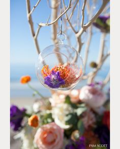 love the hanging glass balls filled with flowers! ~ we ❤ this! moncheribridals.com