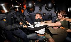 Spain reels at violent tactics by riot police