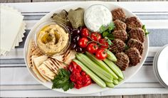 Platter Recipe Roasted garlic, Cherry tomatoes and Red peppers, Antipasto Dip from 9 Fabulous Feta Dips Spreads Recipes Th. Meze Platter, Baked Spinach Artichoke Dip, Greek Appetizers, Greek Meatballs, Greek Dishes, Lunch Snacks, Lunches, Veggie Tray, Food Platters