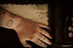 I like the idea of a stamp tattoo, maybe somewhere I've travelled?