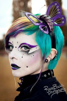Colorful crystal accented artistic make-up with purple glitter eye brows.