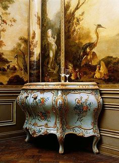 Louis XV painted commode with painted wall paneling.
