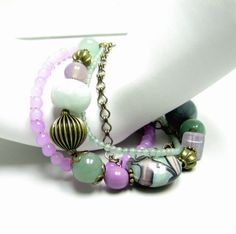 Purple and green bracelet set by beadstreetgallery on Etsy